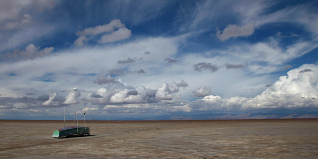 In this January 12 2016 photo, an abandoned boat lies on the dried up lake bed of Lake Poopo. Photo / AP