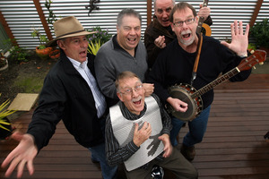 Alec Wishart, centre, with his band Hogsnort Rupert. Photo / Supplied