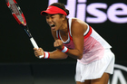 Shuai Zhang of China celebrates winning her first round match against Simona Halep of Romania. Photo / Getty Images