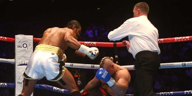 David Haye (L) of England is pushed away by the referee after knocking out Mark De Mori of Australia. Photo / Getty Images.