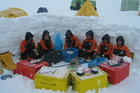 Antarctic field training involves camping out on the ice and creating a
