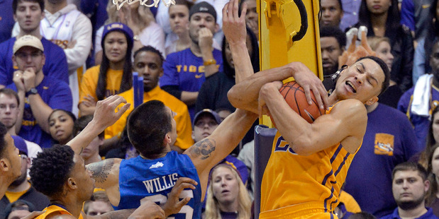 LSU forward Ben Simmons vies for a rebound with Kentucky forward Derek Willis during an NCAA college basketball game. Photo / AP