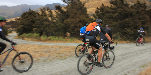 Richie McCaw (wearing orange backpack) is taking part in a 45km mountain bike race and 25km run. Photo / Margot Taylor, Otago Daily Times