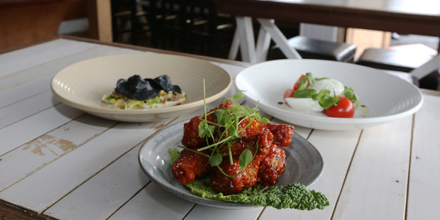 black ravioli, Korean chicken, and mozzarella at The Chapel Bar and bistro. Photo / Doug Sherring