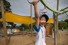 Tianze Wang, 3, of Eastern Auckland, plays on the playground at Sherwood Reserve where new sunshades have gone up.  Photo / Nick Reed