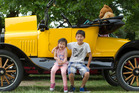 VINTAGE FUN: Kenneth Yang, 11, and Miya Pan, 3, with a 99-year-old Ford Model T. PHOTO/BEN FRASER.