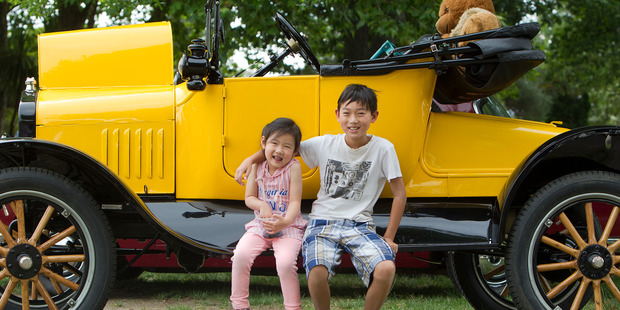 Loading VINTAGE FUN: Kenneth Yang, 11, and Miya Pan, 3, with a 99-year-old Ford Model T. PHOTO/BEN FRASER.