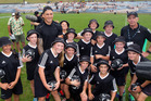 Sonny Bill Williams and All Black sevens coach Gordon Tietjens meet local ball boys and girls at the Bayleys National Sevens at the Rotorua International Stadium on Saturday.  Photo/Ben Fraser