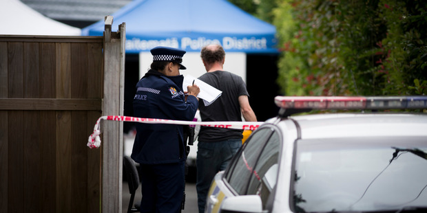 Police continue their investigation at the scene on Glenvil Lane, Te Atatu where Cunxiu Tian was beaten to death in her own home last Friday. Photo / Dean Purcell