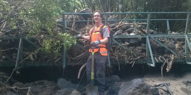 BIG FIX: DOC service ranger Benjamin Scrimgeour works on track repairs after the flooding.