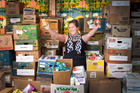 Shelly Fischer is more than happy with the foodbank's stocks. PHOTO/ ANDREW WARNER