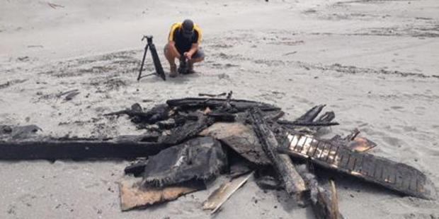 Debris which washed up on a beach after the boat blaze. PHOTO/FILE