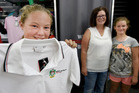 Back to school uniform purchase. Ashleigh Keach, 13, Karla Keach, and Brooke Keach, 10. Photo/George Novak
