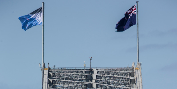 The alternative flag (left) will fly on the Auckland Harbour Bridge ahead of a referendum to decide if it will replace the current New Zealand flag. Photo / Greg Bowker