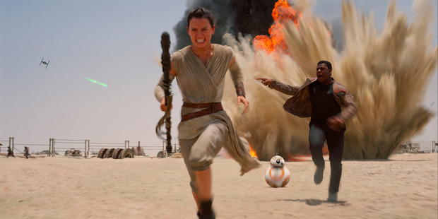 Daisey Ridley as Rey and John Boyega as Finn, in a scene from Star Wars: The Force Awakens.