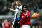Yoan Gouffran and Marouane Fellaini jostle for possession during Manchester United's 3-3 draw at Newcastle in what was a shambolic display at times. Photo / AP