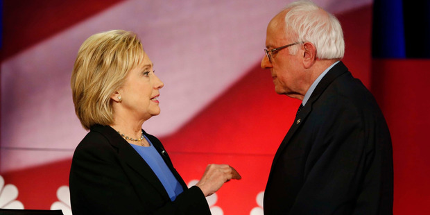 Democratic presidential candidate, Hillary Clinton and Democratic presidential candidate, Sen. Bernie Sanders speak during a break at the NBC, YouTube Democratic presidential debate. Photo / AP