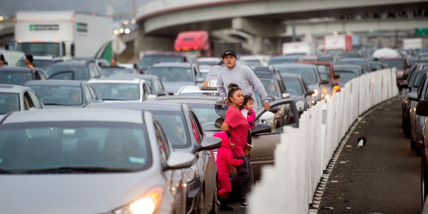 Motorists exit their vehicles as Black Lives Matter protesters block traffic on the San Francisco-Oakland Bay Bridge to demonstrate against police brutality. Photo / AP