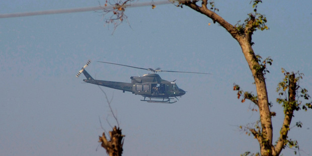 A Pakistan army helicopter flies over the Bacha Khan University. Photo / AP