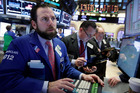 Specialist Michael Pistillo, left, works with traders at his post on the floor of the New York Stock Exchange. Energy stocks are leading another sell-off on Wall Street. Photo / AP