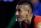 Nick Kyrgios of Australia waits to receive serve from Tomas Berdych of the Czech Republic during their third round match at the Australian Open. Photo / AP.