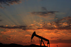 When the price of a key input such as oil comes down as much as it has in recent months, supply-side theory would tell you this is pro-growth. Photo / AP