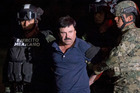 Mexican drug lord Joaquin 'El Chapo' Guzman is escorted by army soldiers to a waiting helicopter. Photo / AP