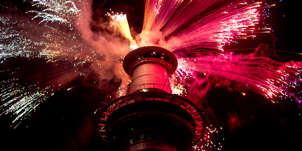 Fireworks explode off the Sky Tower in central Auckland. Photo / Dean Purcell