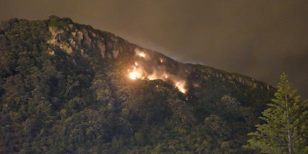 Loading Mauao on fire. Photo/George Novak
