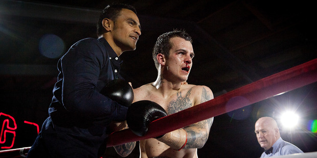 """Gunnar Jackson, left, celebrates with Anthony """"TNT"""" Taylor after his win over Darren Askew in Tauranga last August."""
