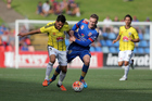 Justin Gulley of the Phoenix contests the ball against Ryan Kitto of the Jets during the round 15 A-League match between the Newcastle Jets and the Wellington Phoenix at Hunter Stadium on Sunday.