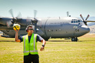 AC aircraftsman Amaan Khan has some fun after getting the Hercules transport aircraft ready for Operation Skytrain. Photo / Warren Buckland