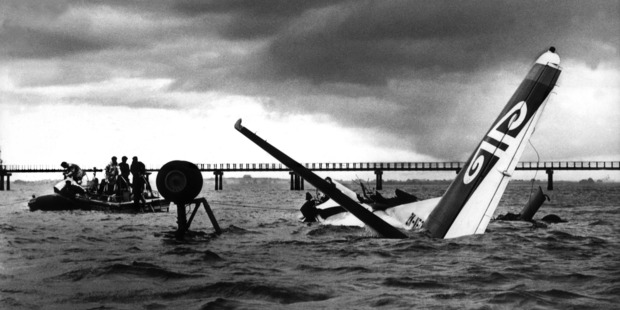 Navy divers check the wreck of a Fokker Friendship that crashed in the Manukau Harbour on its approach to the airport, killing two of the four crew.