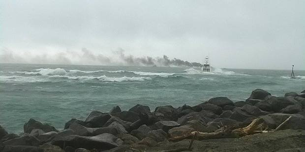 A passenger boat on fire off the coast of Whakatane. PHOTO/KATEE SHANKS