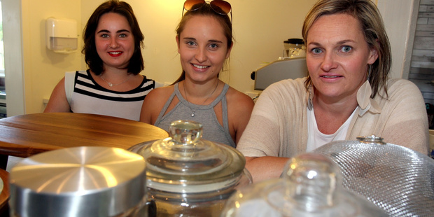 Isa von Ohlen (left), Danida Baiti and owner Andrea Didsbury behind the counter at The Land Girl Pirinoa Coffee House, a former blacksmith's shop on Lake Ferry Rd. PHOTO/LYNDA FERINGA