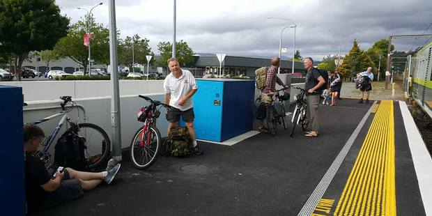 Colin Dowd, centre, waits at Upper Hutt Railway Station with other cyclists for a train that has space to take his bike on to Wairarapa. PHOTO/LEE CARTER