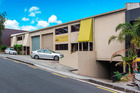 The two level office and warehouse building for sale at 6-10 Nikau St, Eden Terrace.
