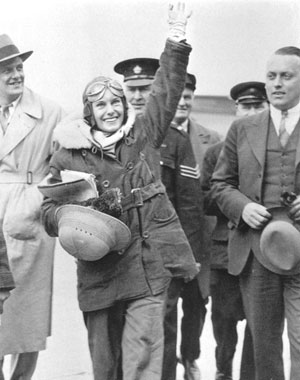 A huge crowd welcomes Jean Batten after her solo flight from England.