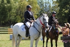 COMPETITION: Simon Wilson (left), riding McMillans Midway Smooth Dude, was just beaten by his wife Claire Wilson on McMillans Tipsy at Saturday's Equipage Grand Prix. PHOTO/SUPPLIED
