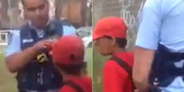 """Loading Police tell the boy to """"settle down"""" before removing his handcuffs. Photo / Screengrab / Facebook"""