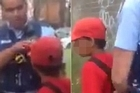 The mother of a 12-year-old Australian boy accused of throwing rocks at passing cars filmed him swearing at police officers as they arrested him.