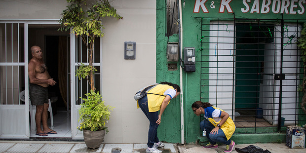 Workers investigate a water line in Recife, Brazil, last week as part of a major effort to eliminate mosquito larvae and halt the spread of the Zika virus. Photo / The Washington Post