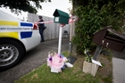 DEATH: Flowers and police at the home of Cunxiu Tian.PHOTO/NZME