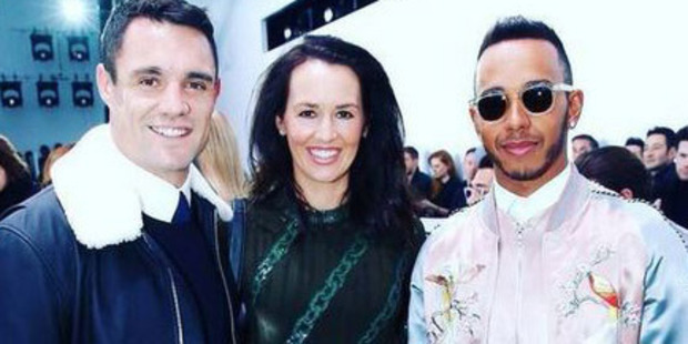 The rugby legend and his racing friend Lewis Hamilton up their fashion game to sit front row. Photo / Twitter, @HonorCarter