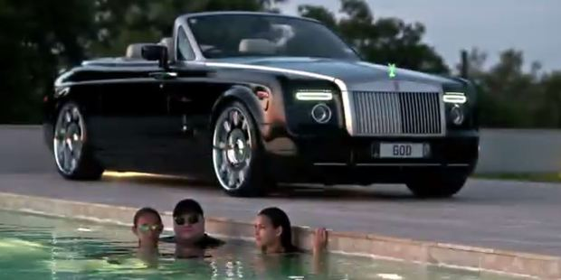 When Kim Dotcom lounges with ladies in the pool, it's necessary to park a nice car nearby.