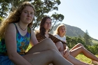Clair Hill with friends Olivia Bell, and Jaimee Peterson are all gutted about the Mauao fire. Photo / Ruth Keber
