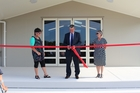 OPENING: Outgoing Napier Boys' High School principal Ross Brown cuts the ribbon, while Napier Community High School chairwoman Caroline Lampp (left) and director Sharon Dudding look on. PHOTO/SUPPLIED