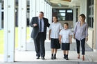ACG Tauranga's new principal Shawn Hutchinson, his wife Mayumi, and their daughters Lina, and Mei. Photo/John Borren