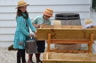 Kerikeri kids William and Cordelia Edwards get a taste of children's household chores in the 1800s. Photo / Heritage NZ