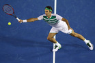 Roger Federer plays a forehand return during his win. Photo /Getty